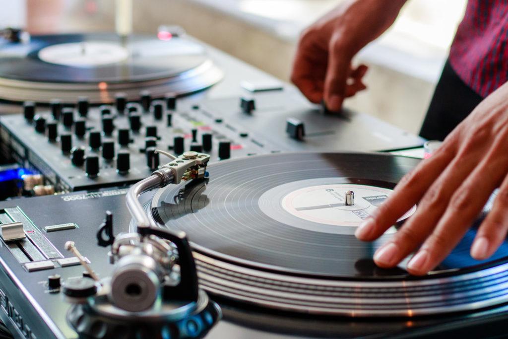 DJ on turntable spinning vinyl records